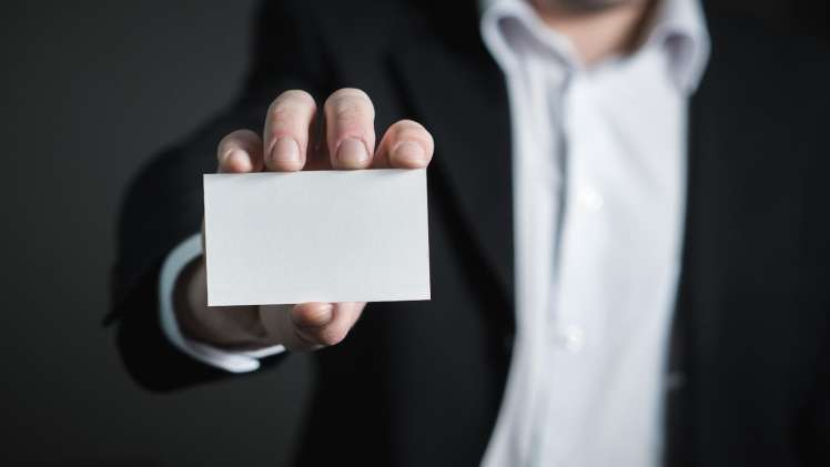 Person Holding a Blank Business Card